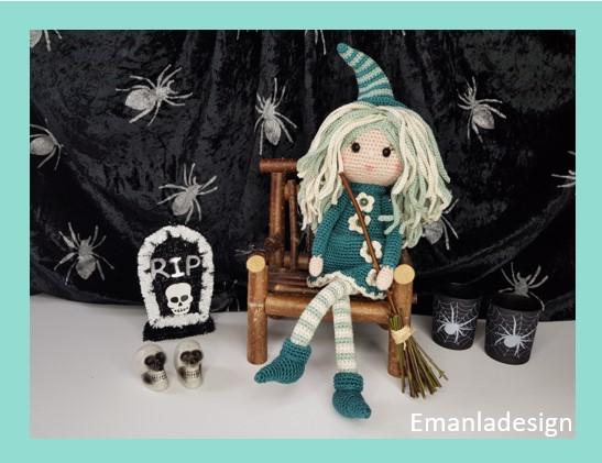 Heks med kjole, stribede strømper og spidse sko og hat - masser af langt hår